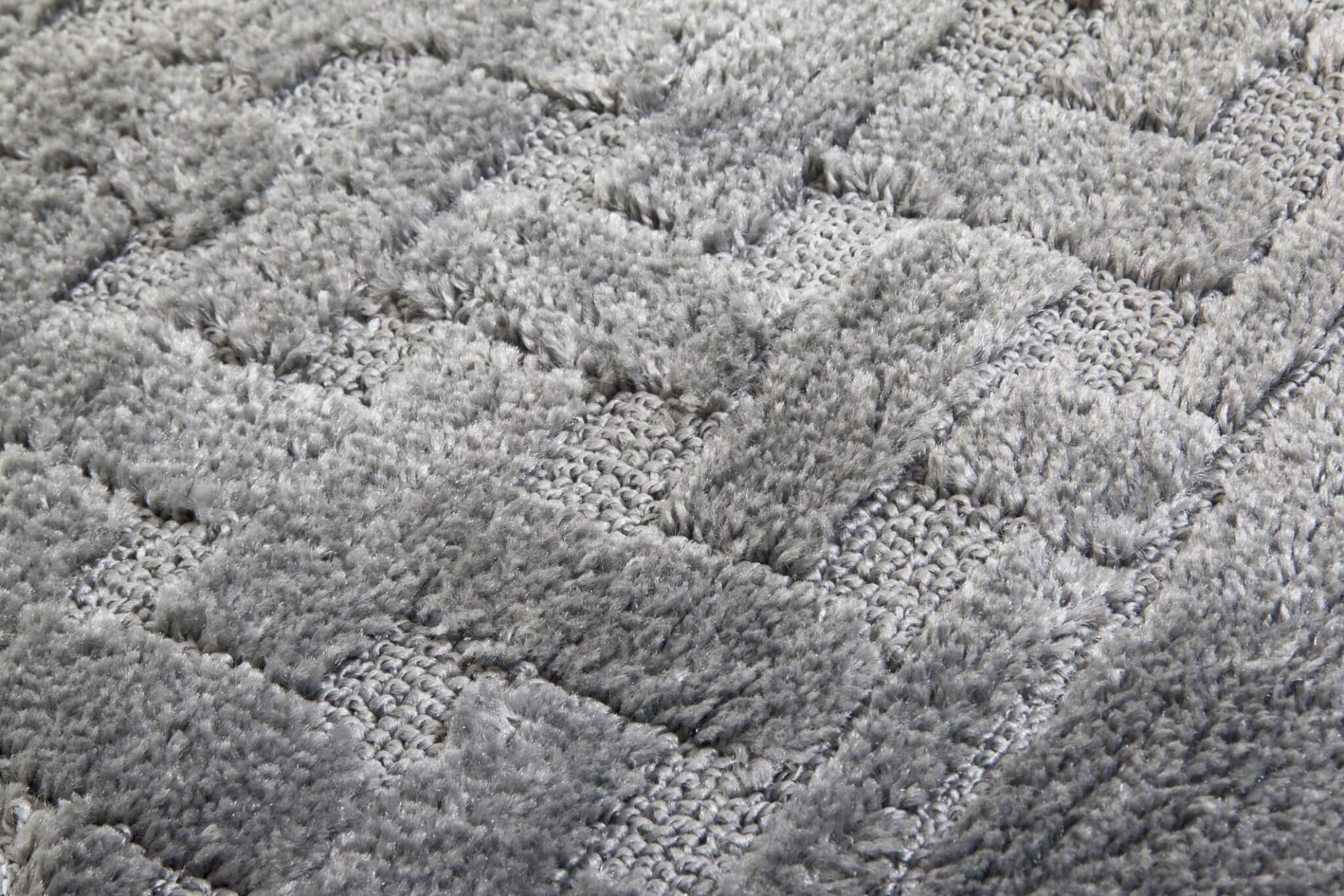 Gray Carpet With Criss Cross Pattern